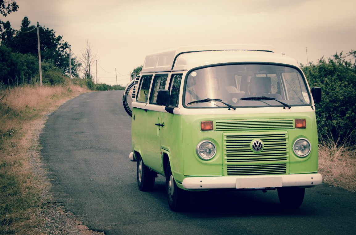 green-volks-wagan-on-road