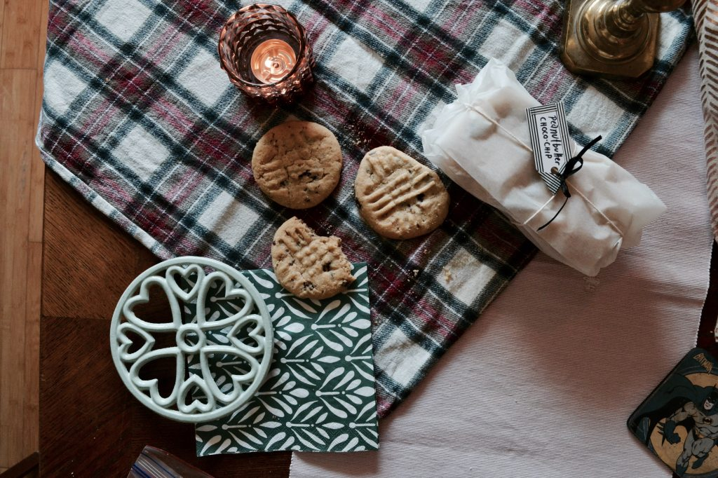 cookies-on-table-with-candle-and-scarf